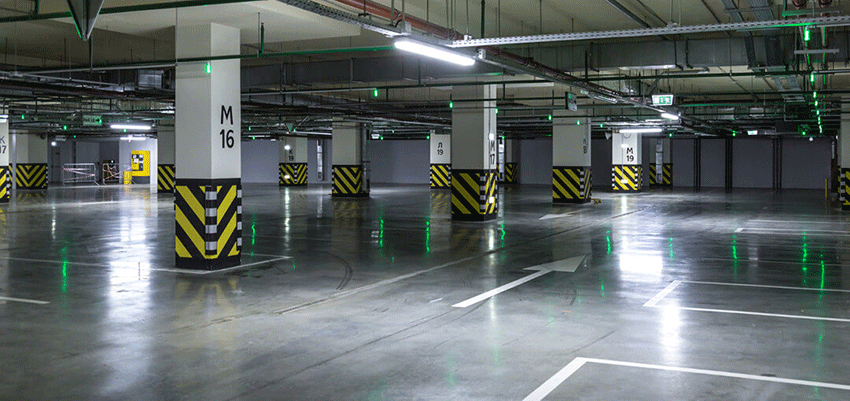 ez-clear flooring system goes perfect on parking garage floors, protecting floor and exposing direction signals